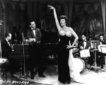 Frank Sinatra watches as Rita performs the 'Zip' number in Pal Joey