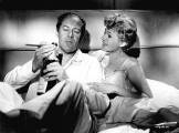 with Rex Harrison in The Happy Thieves