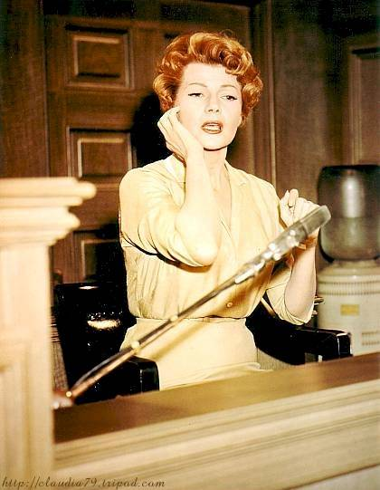 Rita Hayworth as Jo Morris, being questioned in a scene from 'The Story On Page One'