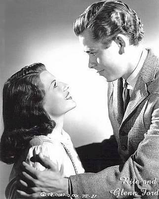 Rita and Glenn Ford as Natalie Rouguin and Pierre Morestan