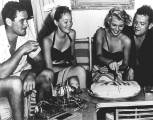 Errol Flynn, his wife Nora Eddington, Rita and Orson Welles celebrate Rita's 28th birthday on location in Acapulco to film The Lady from Shanghai