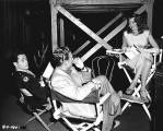 Rita and co-stars Larry Parks and Marc Platt on the Down to Earth set