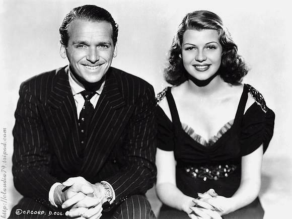 Rita and Douglas Fairbanks, Jr. as Nina Barona and Bill O'Brien
